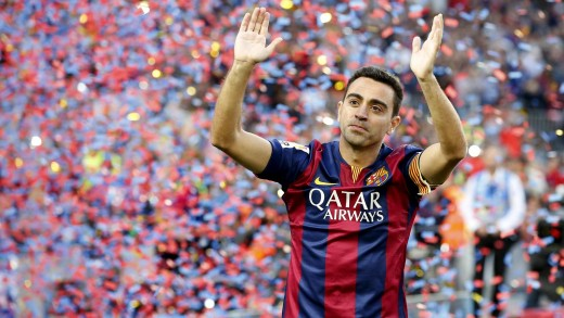Xavi waved goodbye to the Nou Camp after helping Barcelona to the Treble in 2015