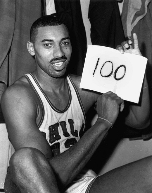 Wilt Chamberlain scoring 100 points in an NBA game.