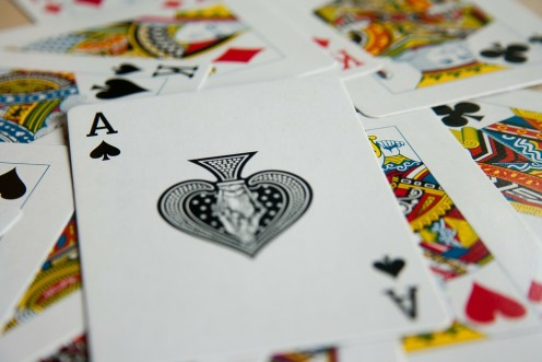Make a banner from two decks of playing cards.