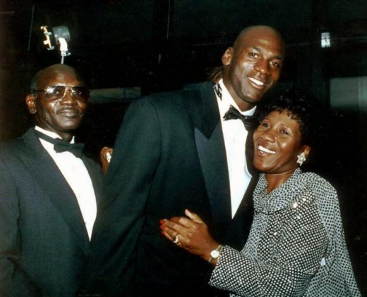 Michael Jordan hugs his mother Delores as his father James looks on in 1990.
