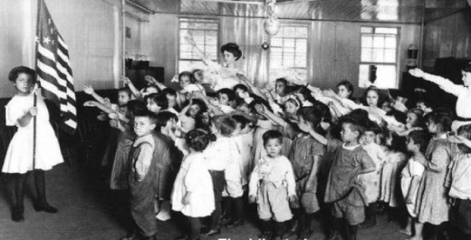 children giving the Bellamy Salute to the flag during the pledge