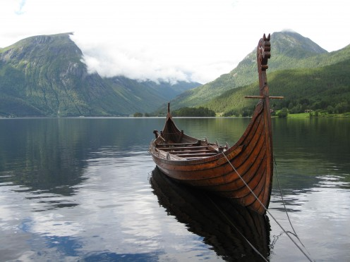 Resting tethered in a Norwegian fjord, a Viking vessel awaits its crew