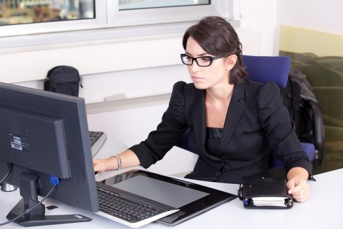 This, to me, is a perfect female employee. She is totally-focused on her computer screen--she is not going about her office gossiping, flirting, or making plans on the job for a big party on the weekend.