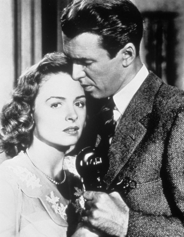 James Stewart & Donna Reed as Mr. & Mrs. Bailey.