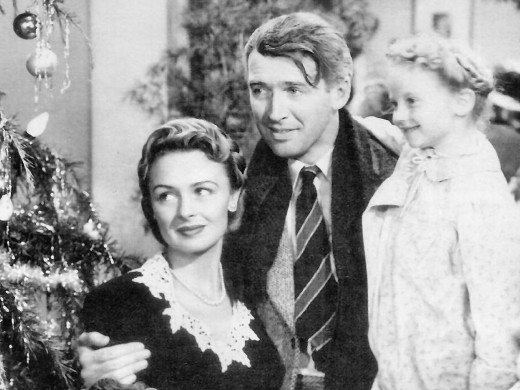 George (James Stewart), Mary (Donna Reed), and youngest daughter Zuzu (Karolyn Grimes)