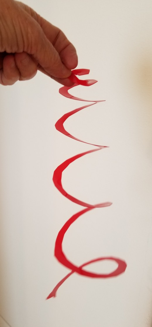 Here's a variation on the spiral. This one is made from a red lid that was a soft, easily-cut plastic.