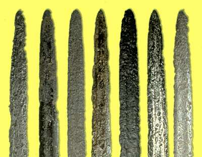Viking age sword blades found at different locations, and in various stages of decay depending on the nature of the ground they were found in.