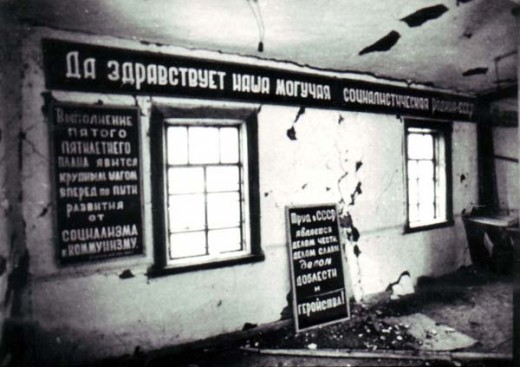 The inside of the barracks at a gulag.