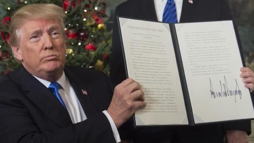 US President Donald Trump with the signed memorandum recognising Jerusalem as Israel capital