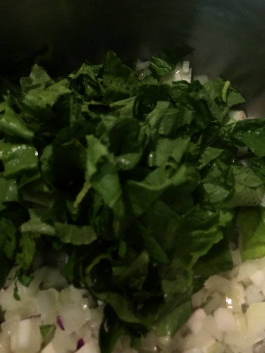 Toss the turnip greens in with the sauteed onion and turnip. Give it a minute, stirring, until the greens wilt. You'll be surprised at how much volume you'll lose - that's ok. As the water evaporates the flavors intensify.