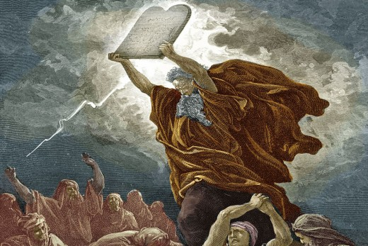 Moses at the base of Mt Sinai with the 10 commandments