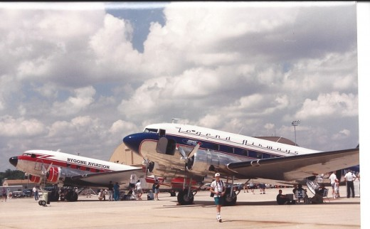Two DC-3s at an Andrews AFB, MD, as part of Freedom Flight America, August 1995.  The airline named indicate their nostalgic purpose.