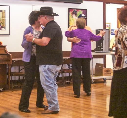 Seniors dancing to the music.