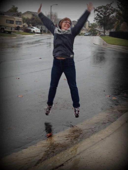Whoopie! It's fun to play in the rain.