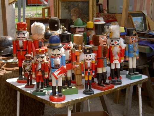A group of older wooden nutcrackers, in the shape of soldiers. Photographed at a flea market in Berlin, Germany, 2006.