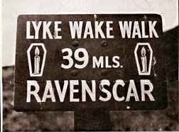 The walk sign - one map says 37 miles, this sign says 39, who's right?
