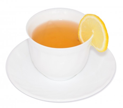 Lemon tea prepared by adding lemon extract to the boiled tea decoction