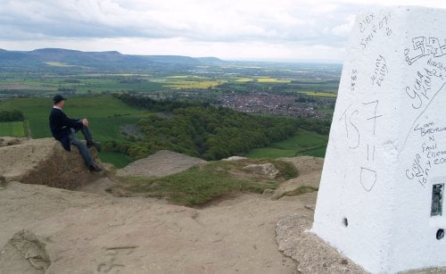 Looking past the Trig Point on Roseberry Topping south-west to the Cleveland Hills