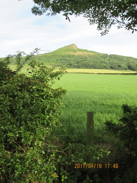 Classic view of Roseberry Topping from Newton-under-Roseberry's eastern car park by the Guisborough road