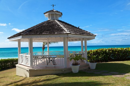 A gazebo at a seaside home offers a restful view of the ocean while enjoying a refreshment break.