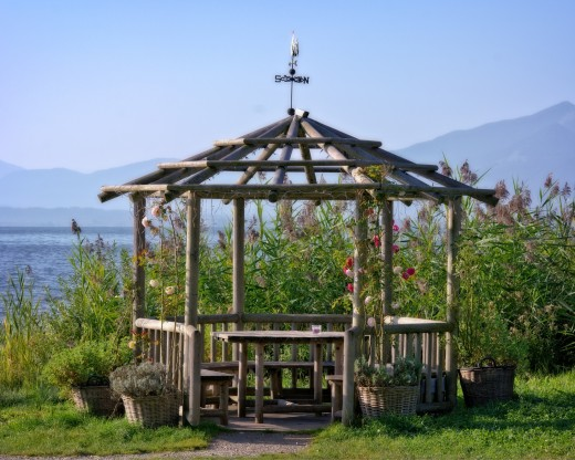 Nature lovers enjoy the rustic gazebo in its wild flowers garden.