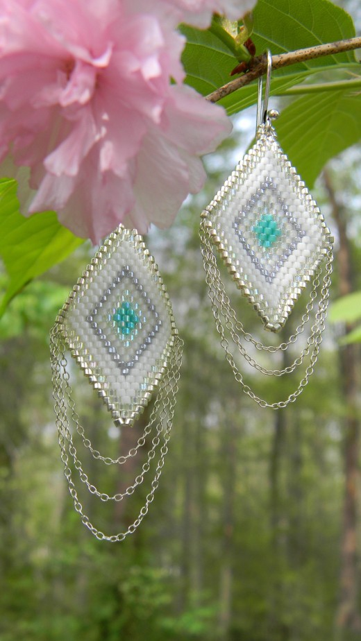 Make a pair of earrings weaving seed beads together.