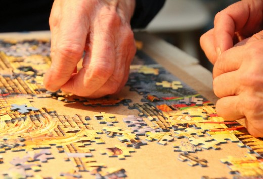 Family and friends enjoy fun, conversations, and relaxed hours together when assembling puzzle pieces.