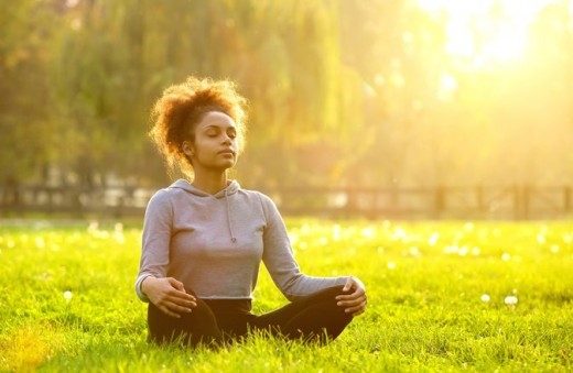 Woman does breathing exercise to calm jittery nerves.