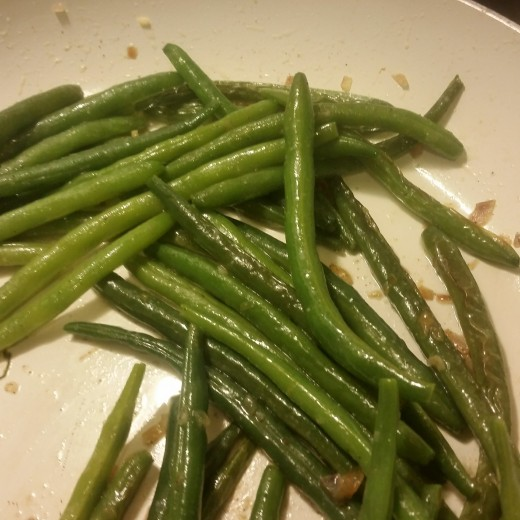 Fried green beans still looking green but now covered in flavor.