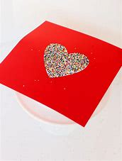 Cut out heart to put sprinkles on cake