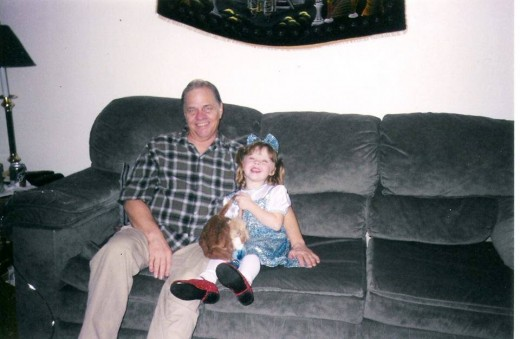 My dad and my daughter Mercedes a month before he passed. He took his oxygen off for this picture so she would not remember him that way.