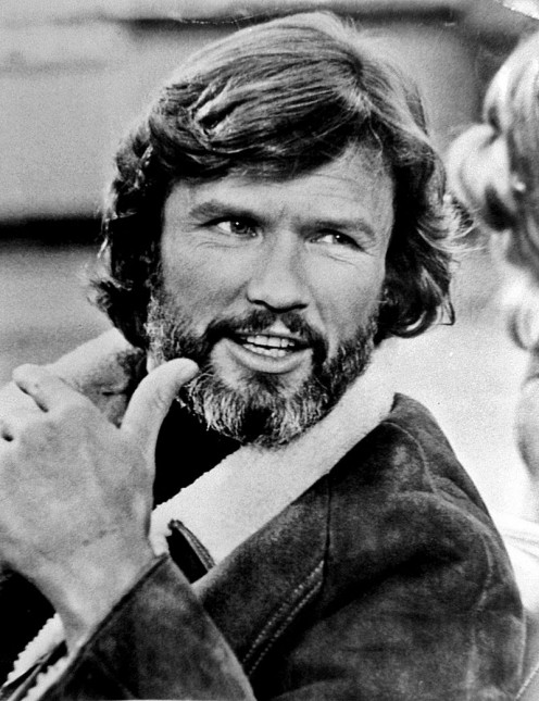 Talent agency publicity photo of Kris Kristofferson, 1977. Kristofferson and Barbara Streisand appeared in yet another version of A Star is Born attempting to show the stress of life on musicians and the use of alcohol as a panacea for that stress.