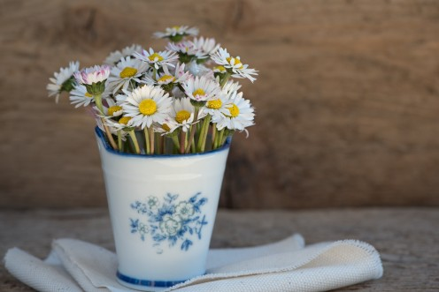 Ceramic container work just as good for a vase.