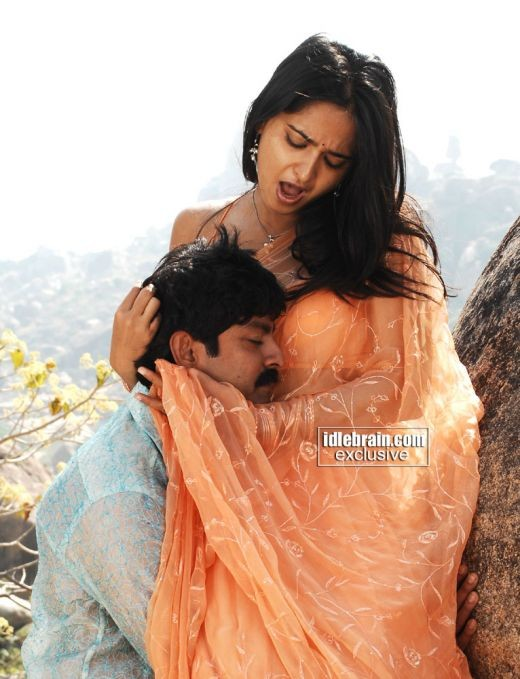 The sensational Anushka looks luscious holding the guy to her marvellous bosom