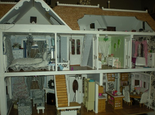 A dollhouse filled with typical everyday furniture and furnishings (miniature home)