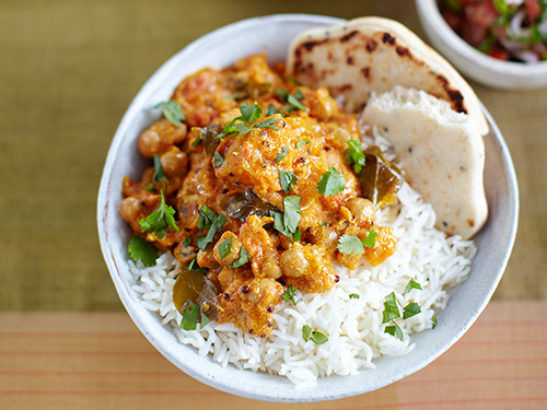 chickpea curry with rice, pumpkin and naan bread