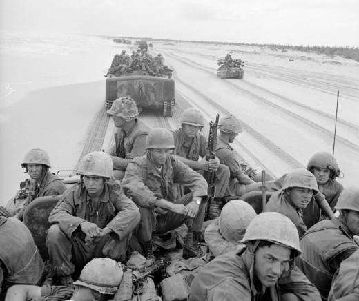 U.S. Marine Corps LVTP-5 amphibious tractors transport 3rd Marine Division troops in Vietnam, 1966.
