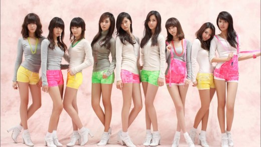 "Girls' Generation posing in their iconic white or grey shirts and colored bottoms, the outfits used on ""Gee."""