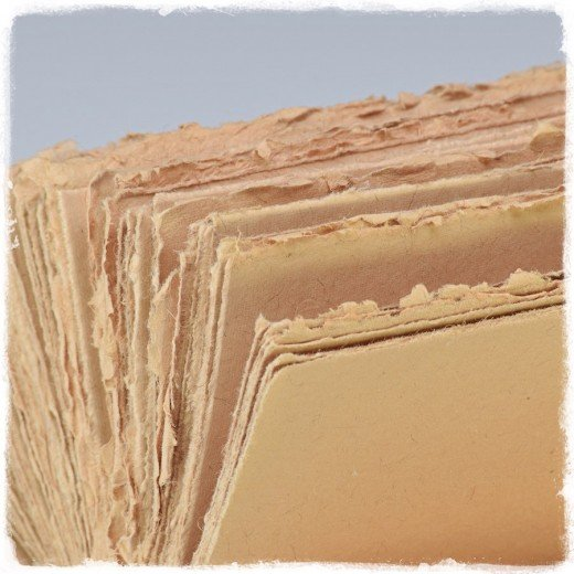 This photo captures a type of paper used, handmade paper, that is a choice of many of the journals