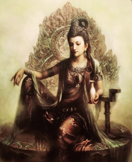 Buddhist goddess Quan Yin is often depicted as a beautiful woman dressed in white, seating on a lotus and holding a vase with water or nectar.
