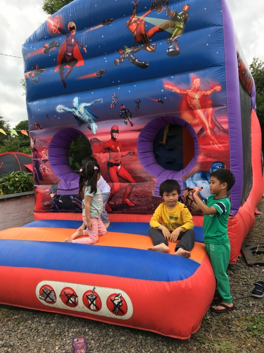 Kids enjoying the bouncy castle. The adults couldn't help themselves and joined the fun.