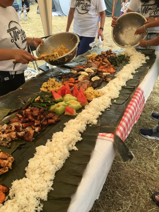 Esprit de Corps. The spirit of camaraderie is highlighted with a boodle fight. Everyone gathers around the table and eat with bare hands.
