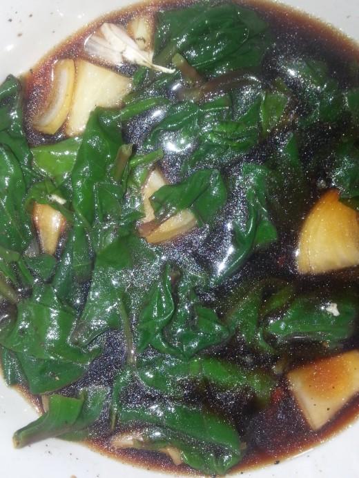 Boiled Alugbati soaked in vinegar mixture.