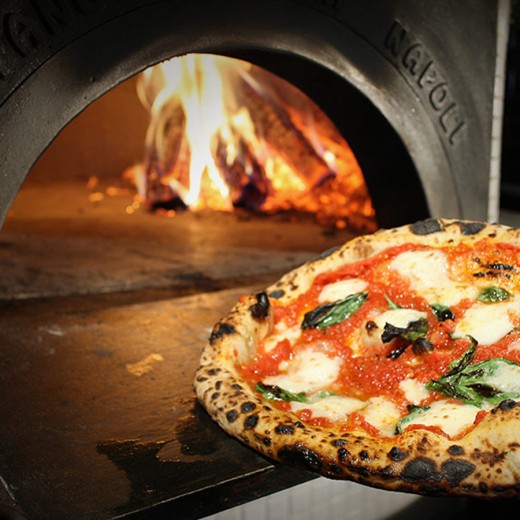 Traditional Pizza Margherita in a wood-fired oven