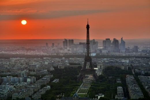 Pink and orange skies surrounding the Eiffel Tower in Paris!