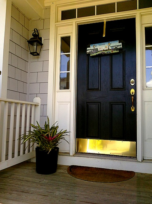 If you can't replace the front door, add new brass hardware to give it a quick update.