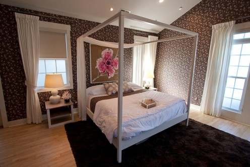 An area rug in the bedroom gives it a warm, cozy feel.