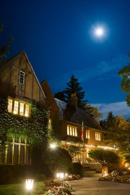 The English Inn exterior at night in moonlight