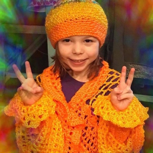 This gorgeous jacket and cap were made by Abby Blackburn for this little show off's mother, but apparently she has claimed it for herself.  This is six-year-old Marasi from Georgia.