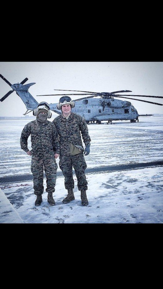 This is a picture of myself and my good friend Corporal Gregory Smith. This picture was taken in a Southeast asian country where we were providing humanitarian aid for locals affected boy a typhoon.
